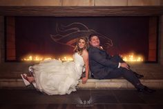LBK Photography  Sports Authority Field Wedding.  Bride and Groom, in the United Club Level. Broncos Fireplace. Colorado Wedding Photography