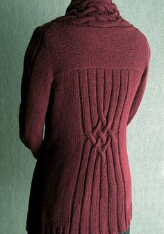 Cardigan with back and bodice yokes, richly cabled shawl collar, plaited cables down sleeves and a flattering cabled lattice whittling the back waist. Wear open or pin it closed. Fabulous!