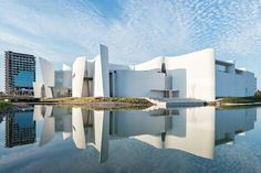 Curled white concrete walls and a water-filled courtyard frame this museum of Baroque art and culture in Puebla, Mexico, by Japanese architect Toyo Ito.