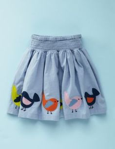 I think this would be so easy to make with iron-ons and a ready made skirt.