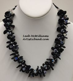 Kumihimo Necklace with black leaves by Leah McWilliams.  See more Kumihimo and other bead projects at www.artisticbead.com.