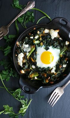 Baked breakfast greens with creamy goat cheese and a runny egg, the perfect way to start your healthy day!