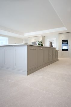 A subtle and beautiful stone floor, our Versailles limestone tiles have a softly aged finish yielding a pale wash tone with delicate fossil details and markings. Large Kitchen Tiles, Grey Kitchen Floor, Large Floor Tiles, My Living Room, Living Room Flooring, Kitchen Flooring, Home Decor Kitchen, Kitchen Interior, Kitchen Design