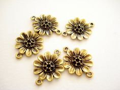 Hey, I found this really awesome Etsy listing at https://www.etsy.com/listing/76209297/10pcs-sunflower-24x18mm-antiqued-gold
