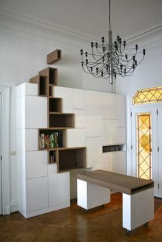 """Renowned for his unique aesthetic and love of asymmetry, Belgian interior and furniture designer Filip Janssens has created Rupture, an unmistakably modern cabinet that features a stylized """"crack"""" fracturing its façade. With ample cupboard space and shelves of various sizes, the striking storage unit is as practical as it is beautiful. Like many of Janssens' statement pieces, Rupture incorporates a fissure motif in its design. A cluster of wooden drawers and shelves cut through its…"""