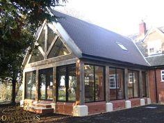 Sunroom with glazed gable and oak frame glazed walls linked to house