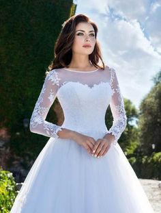 Carolyn is a traditional wedding gown giving a feeling of soft elegance. With the illusion neckline and lace sleeves. The timeless lace bodice which ties up at the back, flowing down to a soft tulle skirt. Lace Bodice, Lace Sleeves, Elegant Bride, Illusion Neckline, Traditional Wedding, Wedding Gowns, Tulle, Romantic, Bridal