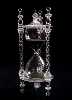 Wow the black sand flowing through this crystal hourglass is gorgeous.