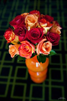 wedding bouquet of red orange and peach roses, pretty colors for a fall wedding