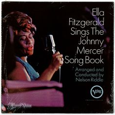"""""""Ella Fitzgerald Sings the Johnny Mercer Song Book"""", by the American jazz singer Ella Fitzgerald, with the Nelson Riddle Orchestra is notable as Fitzgerald's only songbook to concentrate on the work of a lyricist. Riddle's lush arrangements interact most beautifully with Fitzgerald on ballads like """"Midnight Sun"""" and """"Skylark"""". Fitzgerald's impeccable swing is most evident on """"Something's Gotta Give"""" and """"Too Marvelous for Words"""". The album peaked at #14 on Billboard's Top Jazz Albums. (Vinyl…"""