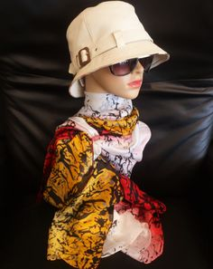 Burberry hat and colorful scarf