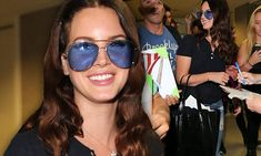 Lana Del Rey smiles as she mingles with autograph-seeking admirers beautiful just beautiful in love love