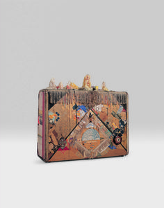 Suitcase with metal closures, paper, fabric, beads, fringe, candles, trading stamps, mirror, half of a yo-yo, fur, gold and silver foil, paint, and graphite 22 × 24 × 9 in. (55.9 × 61 × 22.9 cm) Frederick R. Weisman Art Foundation, Los Angeles