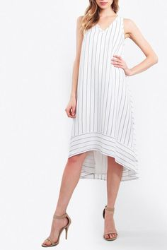 "Midi stripe dress with a high low hem.SleevelessV-neckline curved hem double straps on back.Contrasting stripe trim.  Measurements taken from size S - Length: 39""  Stripe Dress by Sugar Lips. Clothing - Dresses - Midi Clothing - Dresses - Printed Canada"
