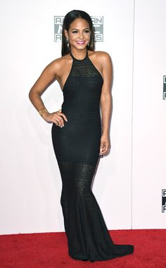 Christina Milian from 2014 AMAs Red Carpet Arrivals%0A%0AThe singer takes to the carpet in a sexy knit halter dress that hugs her enviable curves.