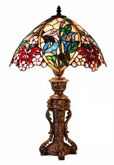 This elegant Flower Design Table Lamp has been handcrafted using methods first developed by Louis Comfort Tiffany. This copy of an American classic puts affordable beauty on a table near you. Featurin