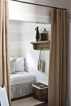 Subtle stripes and tucked-away reading nook that works as a guest room