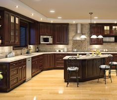 Love the light floor and dark cabinets together!