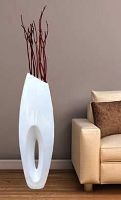 This beautiful and modern white large floor vase will give your living space an extra dash of sophistication. A great accent for an entryway or living room, this vase will elegantly display your decor Large Floor Vase, Tall Floor Vases, Large Vases, Floor Vase Decor, Vases Decor, Tall Vase Decor, Centerpieces, Elegant Home Decor, Elegant Homes