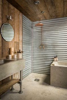 Rustic Bathroom Showers cast concrete shower pan and galvanized walls make a great