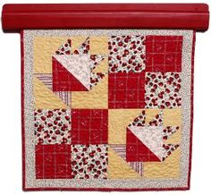Quilted wall hanging, hung on a quilt rack,  manufactured by Walnut Hollow. by www.deniseclason.com
