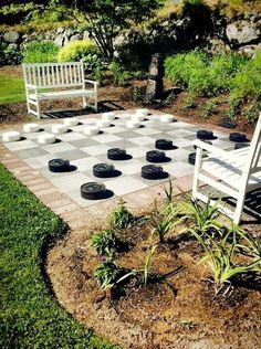 All work and no play makes for a dull life. Work #whimsy into your living space! This #outdoor #lifesize #checkers board can be replicated with #pavestone #patiostones and #pavers. #WednesdayWisdom