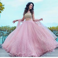 You can be assured to make a great style statement with this pastel pink net lehenga choli.Buy this latest designer lehenga choli online .Paired with matching choli and dupatta. Party Wear Indian Dresses, Indian Fashion Dresses, Indian Bridal Outfits, Indian Gowns Dresses, Dress Indian Style, Indian Designer Outfits, Indian Dresses For Wedding, Net Dresses, Net Gowns