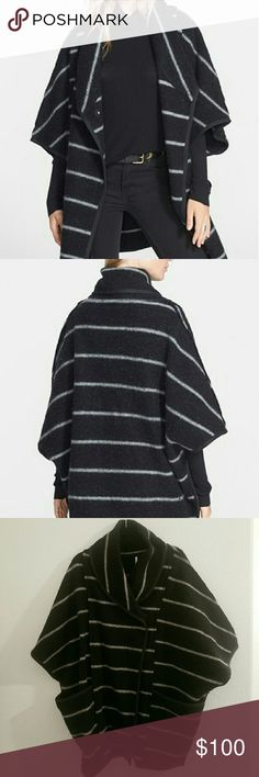 Free People Blanket Poncho Urban twist on the blankets woven poncho with this boxy, longline design featuring moto style lapels Studded with tonal snaps and sleek stripes accented by a tonal trim 87% wool and 13% nylon  Only worn one time  Oversized and super cute & perfect for layering Free People Sweaters Shrugs & Ponchos