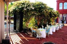 'Carrollton Inn' Baltimore, Maryland. The courtyard tables for wedding guests are draped in celery and white wedding colors. Music performed by Ben Sherman Classical Guitar.