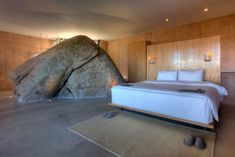 Why have a rock in your home? Why the heck not? Amazing Architecture, Interior Architecture, Interior And Exterior, Interior Design, Cafe Exterior, Boulder House, Casa Loft, Prefab Homes, Beautiful Bedrooms