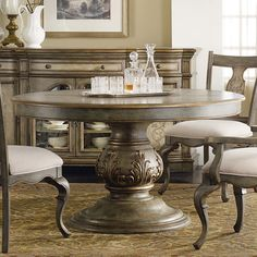 Adorned with scrolling acanthus leaf details, this elegant table brings regal style to your dining room. An extendable leaf lends versatile appeal, offering ...