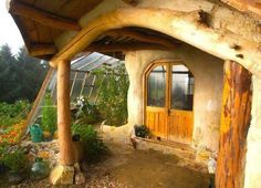 Earthship entry way. Natural wood accents and view of the solarium / greenhouse