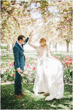 Beautiful long sleeve lace wedding dress with silk skirt for an elegant spring wedding.