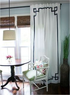 Love the color and texture combination of white chair, floral vs. green fabric, wooden table, linen lamp...