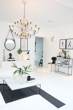 love the black and white scheme, especially the round mirror with the leather strap