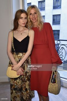 Agathe Bonitzer (L) and Sandrine Kiberlain attend Guy Bourdin inaugural exhibition and unveiling of Maison Chloe as part of Paris Fashion Week at Maison Chloe on July 2, 2017 in Paris, France.