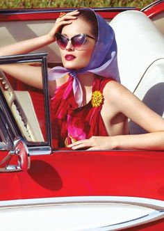 b698f9342903 Inspired by the through the bold red lipstick and dress with a higher  neckline, head scarf and cat eye style sunglasses