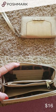 Gold and Silver Wrislet/Wallet Great condition! Reptile Accent. Detectable Strap. Small Silver Bow on Front.  Inside coin purse, credit card holder, cash and phone.6.5 inches wide by 4 inches deep. Francesca's Collections Bags Wallets