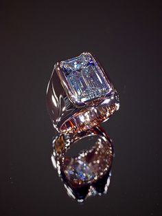 Rose Gold Men's Ring with 8.88 carats Emerald Cut Diamond centre. For a gentleman with discerning taste.