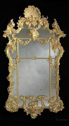 A Very Fine Large Carved Giltwood Rococo Mirror, after Thomas Johnson (c. 1820	England)