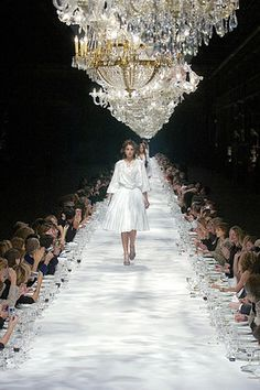 Van Noten's 2004 runway show, celebrating his 50th collection, where editors and retailers dined on a table/runway