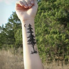One temporary tattoo of a tall pine tree. A dark black silhouette of the forest. Botanical tattoo design. This pine has a couple saplings growing beneath it along with grasses, stones, and a tiny crescent moon that you can wear above your pine tattoo, or cut off and wear it separately! SIZES Small - 3 tall Large - 6 tall This pine tree design is also available in our collection Midnight Pines, check it out ↓↓↓ https://www.etsy.com/listing/502413083/midnight-pines-tem...
