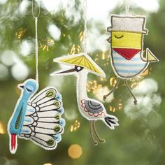 """Suzy Ultman's """"Odd Bird"""" ornaments flock to the tree with fun personalities and artisanal detailing.  Designed just for Crate and Barrel, her quirky bird friends in three styles are crafted in wool and nylon and embellished with elaborate, sparkling embroidery."""