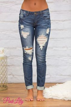 Our Alexandra Distressed Machine Jeans are a perfect addition to your wardrobe! These medium wash denim jeans are easy to pair with a variety of blouses and tanks for a gorgeous look. #jeansoutfit