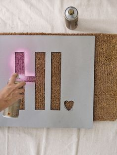 D.I.Y. DOORMAT SPRAY PAINT | LONNY.COM