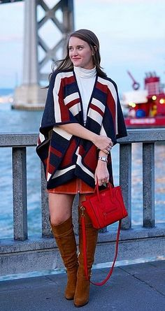 A printed poncho can be the statement piece to your outfit