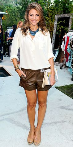 Maria Menounos Maria attended the Beverly Hills designer preview wearing this casual chic ensemble featuring Madewell leather shorts.    The TV host added a billowy cream blouse, a statement Dannijo necklace and a pastel Coach clutch to complete her summer look.