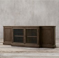 RH's 19Th C. English Notary Media Console:A bookcase used to house deeds and legal certificates for a 19th-century English notary public inspired our steadfast reproduction. The walnut original was hand-distressed, as ours is today.