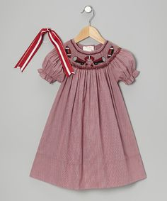From holidays to tea parties, this gingham bishop dress and grosgrain clip is perfect when little girls want to get dolled up. Buttons in back make the dress easy to slip on, while that charming bit of smocking creates an heirloom quality that will always transcend the trends. Includes dress and hair tieHair tie: 7.5'' long