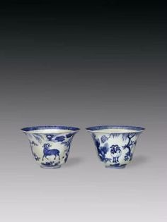 Pair of blue-and-white bell-shaped wine cups with three rams and the sun, Jiajing period (1522-1566), Ming dynasty. Porcelain, Jingdezhen, Jiangxi province. Width 16.4 cm. Height 10.5 cm.